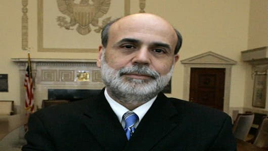 Federal Reserve Board Chairman Ben Bernanke poses in the board room of Federal Reserve headquarters Friday, Jan 26, 2007, in Washington. Bernanke and his colleagues gather Tuesday, Jan. 30, 2007, for a two-day meeting to discuss what is needed to keep the economy on track and improve the central bank's communications with Wall Street and Main Street. (AP Photo/Manuel Balce Ceneta)